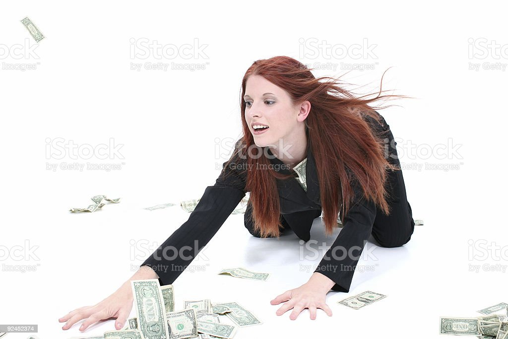 Beautiful Young Business Woman On Floor Grabbing Up Cash royalty-free stock photo