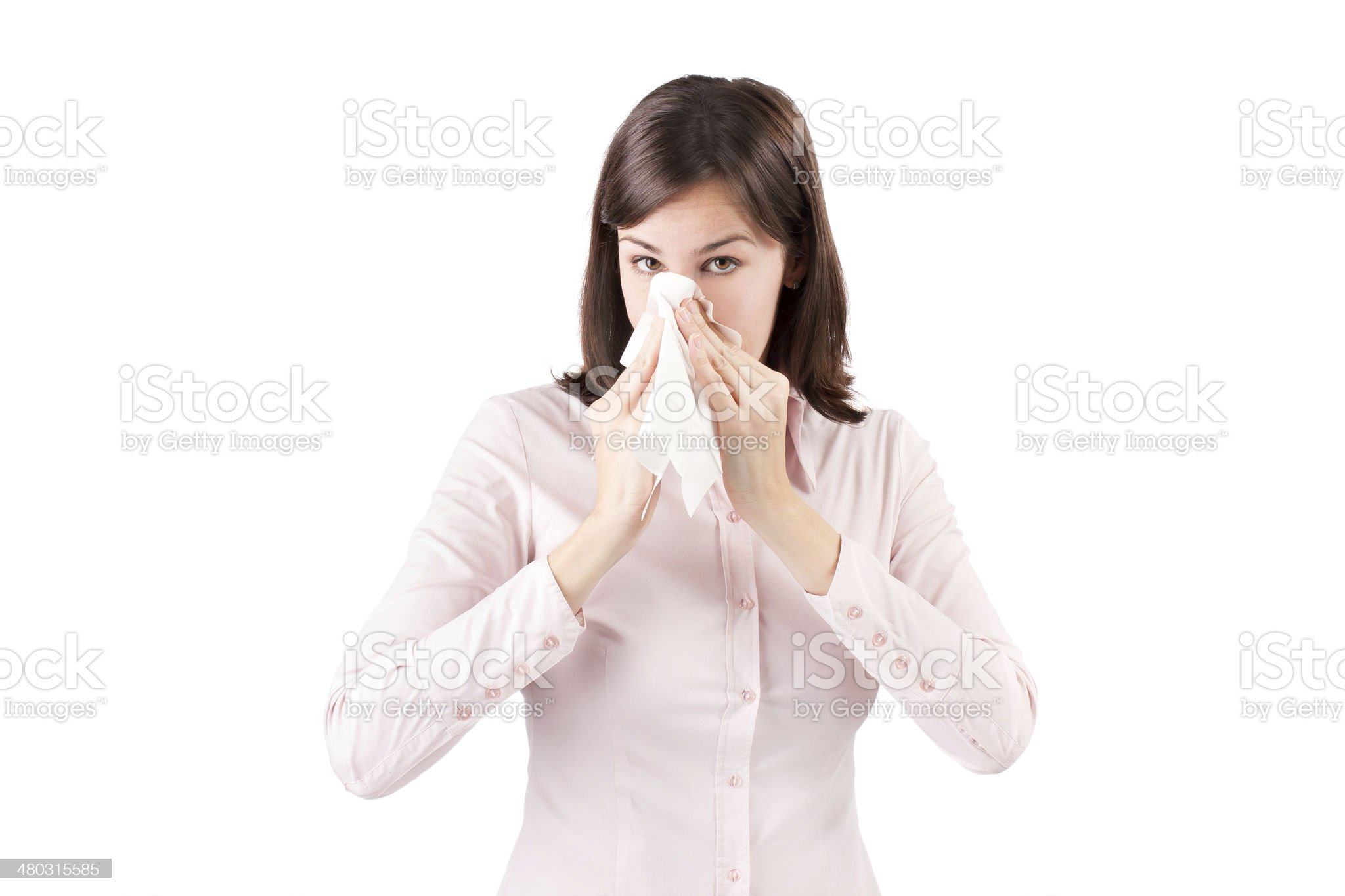 Beautiful young business woman with a cold blowing nose. royalty-free stock photo