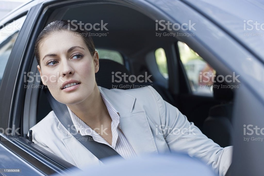 Beautiful young businesswoman driving car royalty-free stock photo