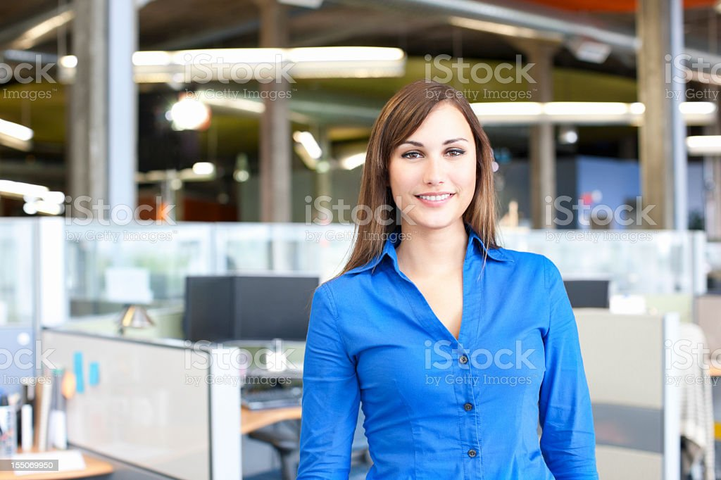 Beautiful Young Businesswoman Portrait in Office Cubicle, Copy Space stock photo