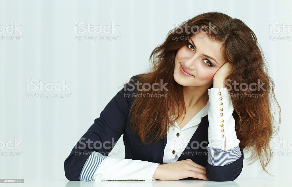 Beautiful young businesswoman sitting at the table stock photo