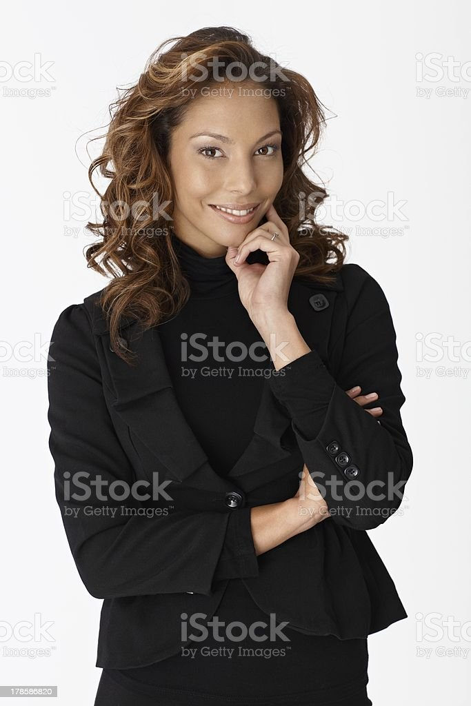 Beautiful young businesswoman smiling stock photo