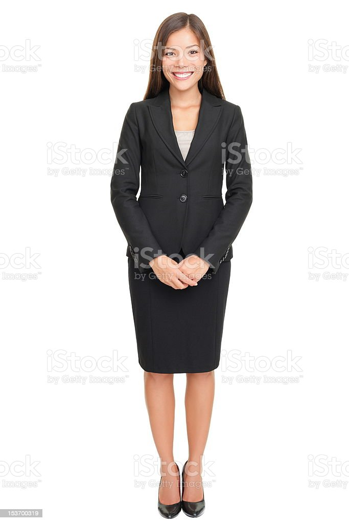 Beautiful young businesswoman standing on white background stock photo
