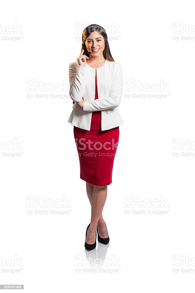 Beautiful young call center representative standing and smiling stock photo
