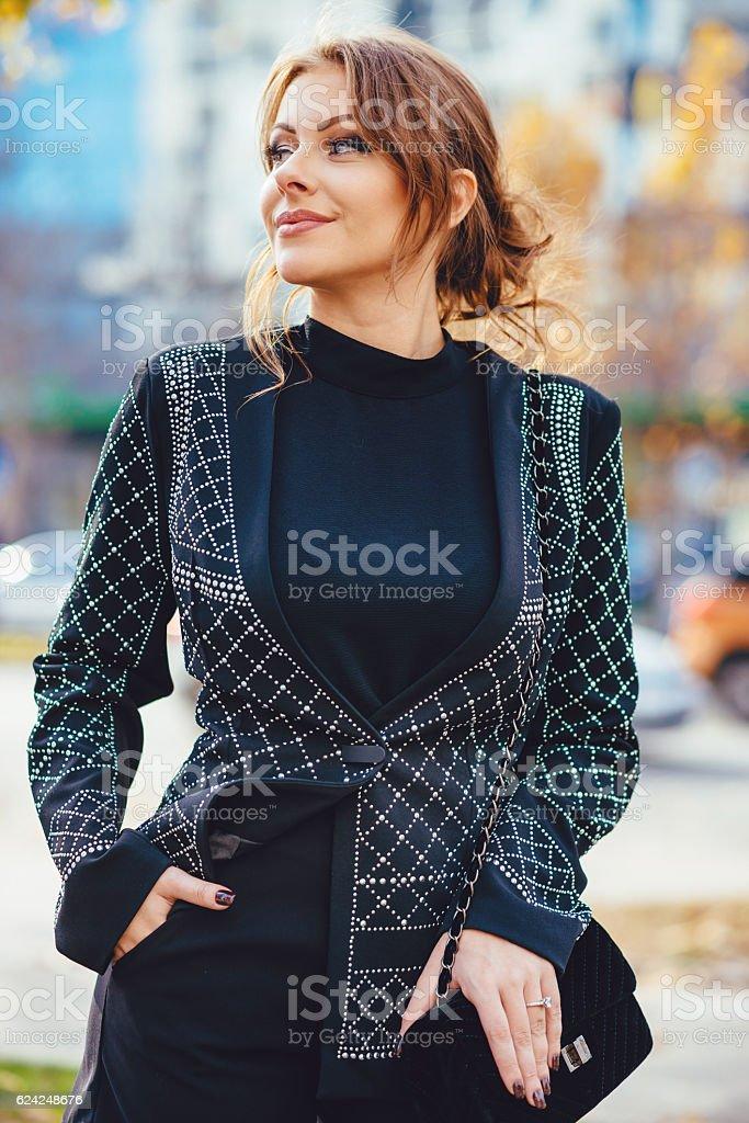 Beautiful young caucasian woman in elegant clothing stock photo