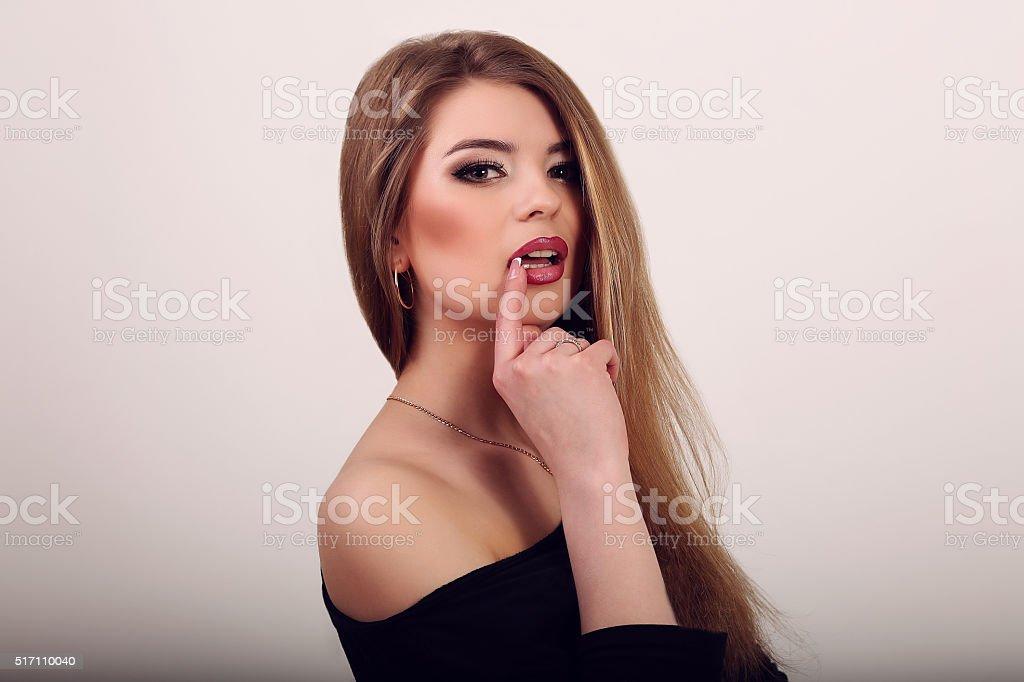 Beautiful young caucasian woman with natural makeup over grey ba royalty-free stock photo