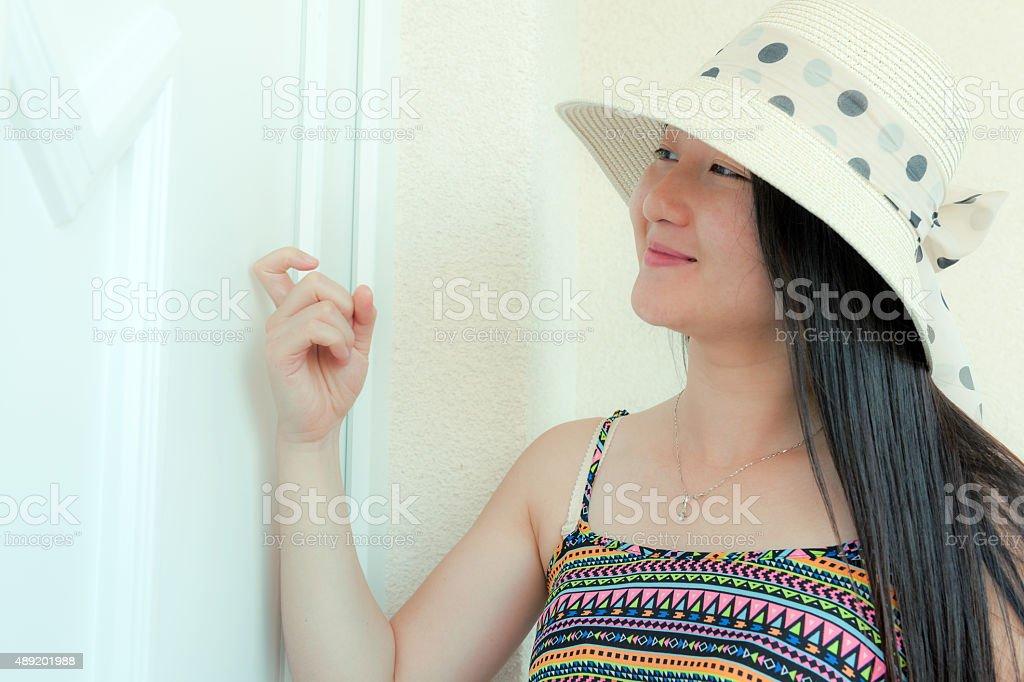 Beautiful Young Chinese Woman Knocking at the door  Koper, Slovenia stock photo