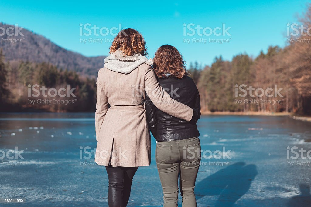 Beautiful young couple by the lake stock photo
