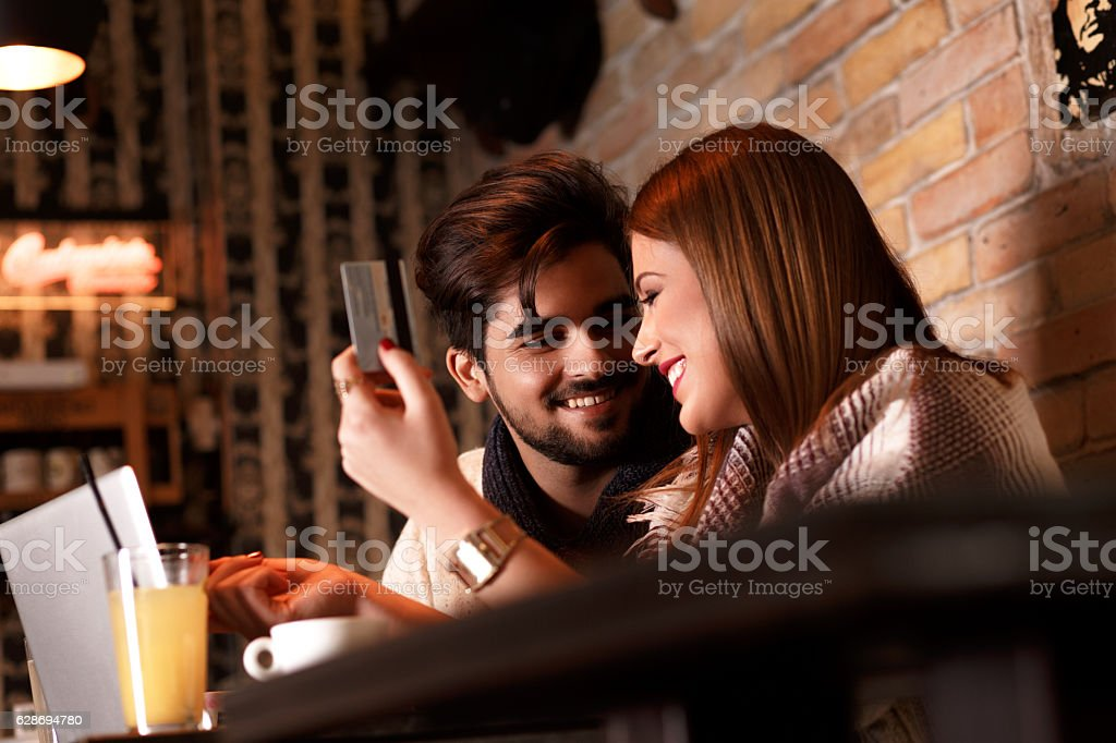 Beautiful young couple in cafe. stock photo