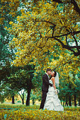 beautiful young couple stand on background forest