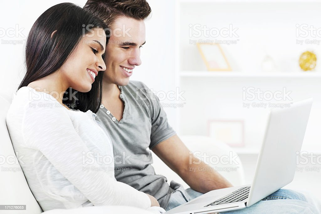 Beautiful young couple using laptop royalty-free stock photo