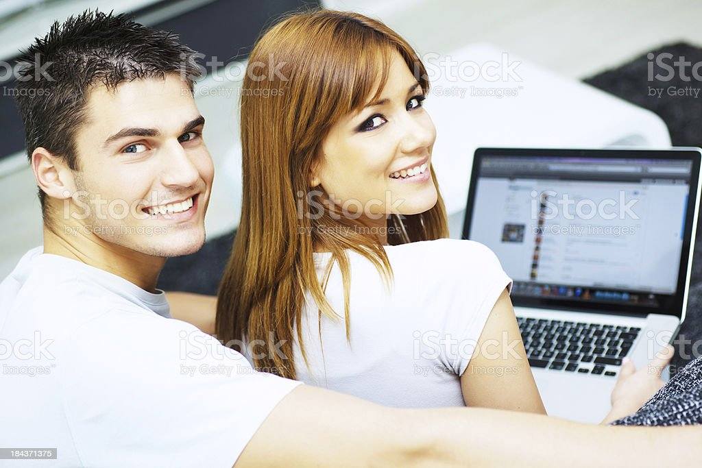 Beautiful young couple using laptop. royalty-free stock photo