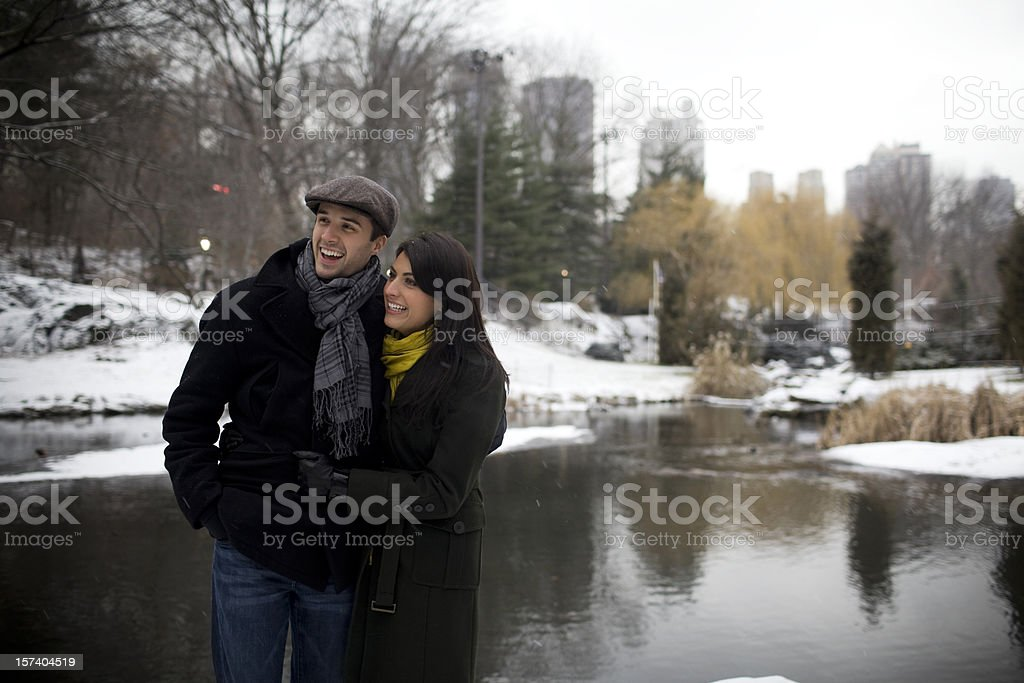 Beautiful Young Couple Walking in Snowy Central Park, Copy Space royalty-free stock photo