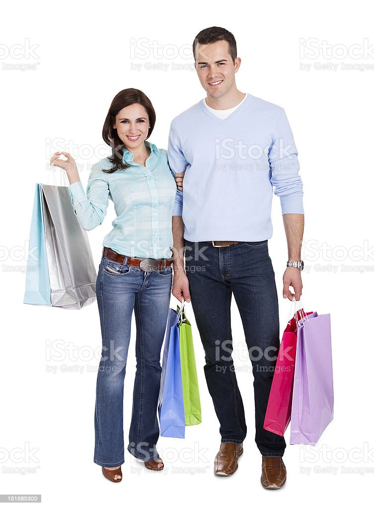 Beautiful young couple with shopping bags royalty-free stock photo