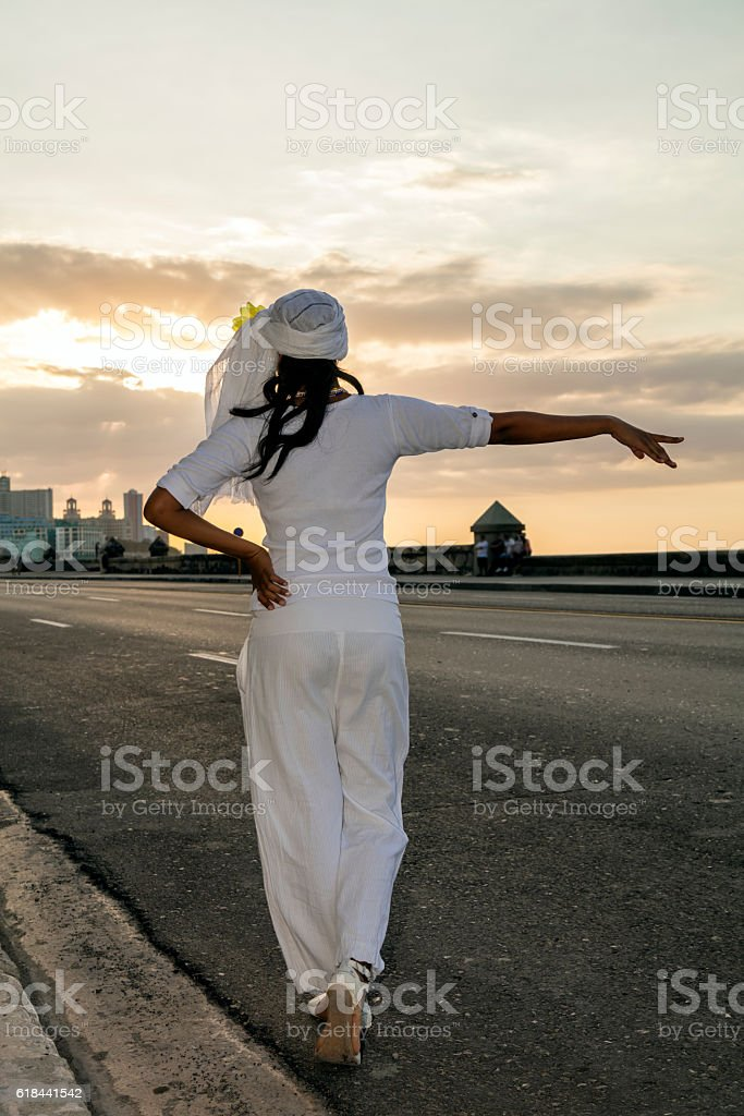 Beautiful, young Cuban woman calling taxi in Havana, Cuba stock photo