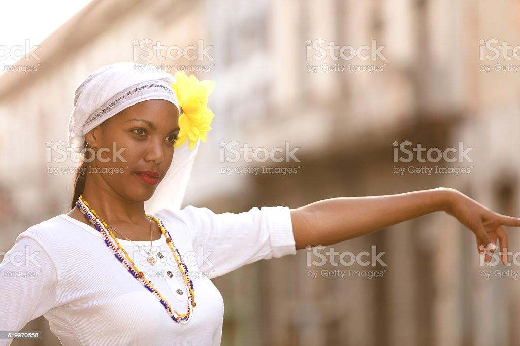 Beautiful, young Cuban woman hailing taxi in Havana, Cuba stock photo