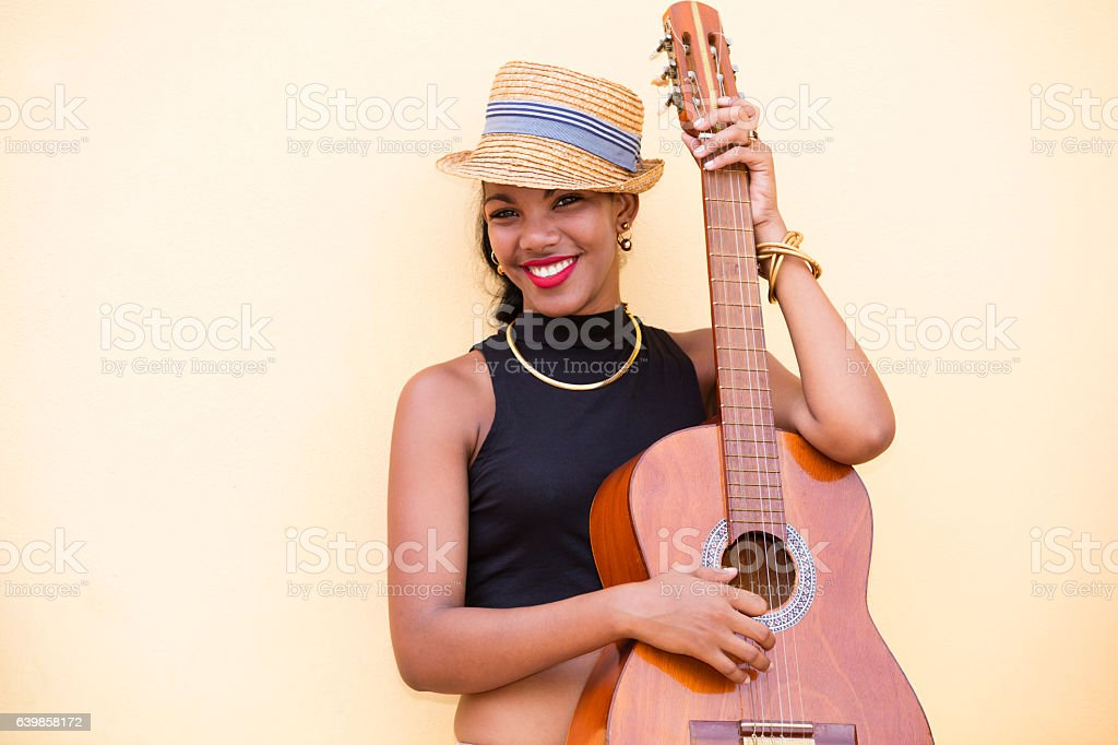Beautiful young Cuban woman with guitar, Havana, Cuba stock photo
