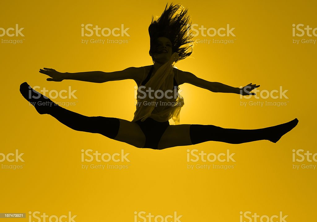 Beautiful Young Dancer Jumps Into Splits, Back-Lit By The Sun royalty-free stock photo