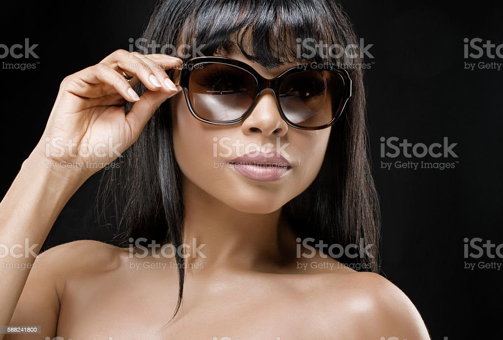 Beautiful young dark haired coloured female posing for  individual shot stock photo