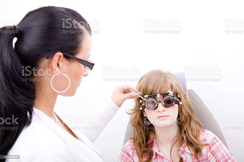 Beautiful young doctor inspect a patient royalty-free stock photo