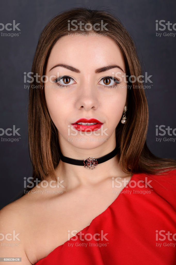 Beautiful young elegant woman in red dress stock photo