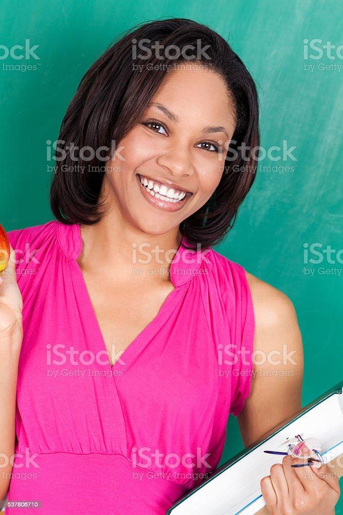 Beautiful young elementary school teacher stock photo