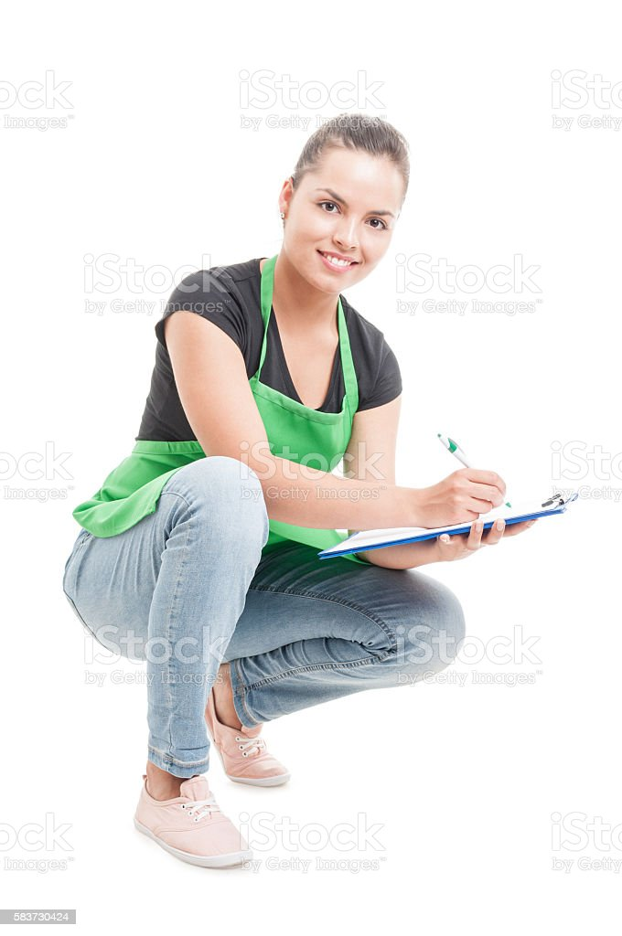 Beautiful young employee checking stock in supermarket stock photo