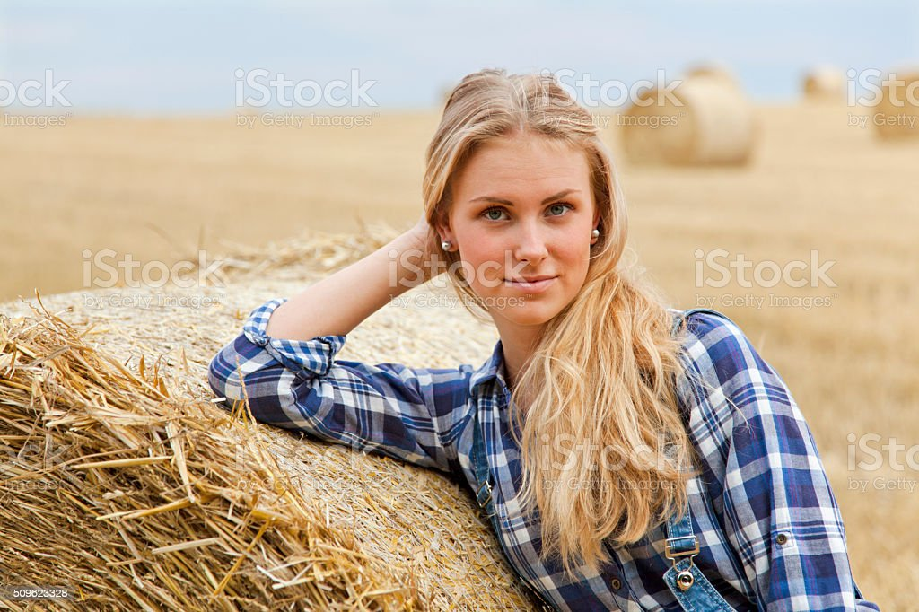 Beautiful young farmer on field stock photo