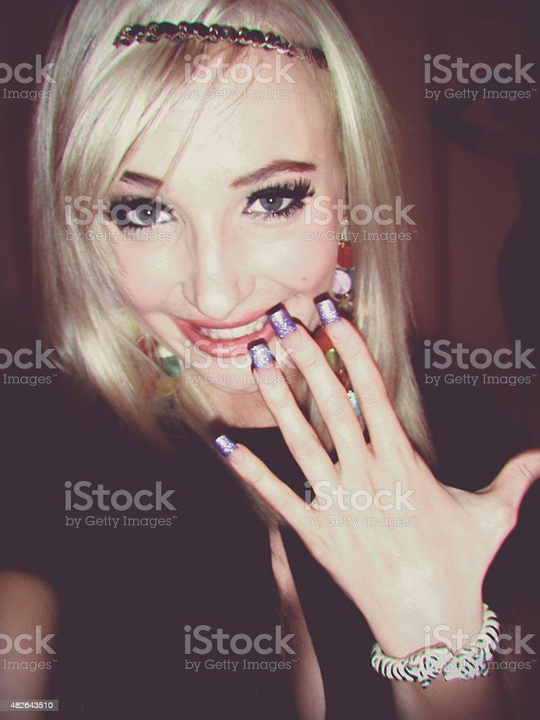 Beautiful young fashion blonde teen taking a selfie stock photo