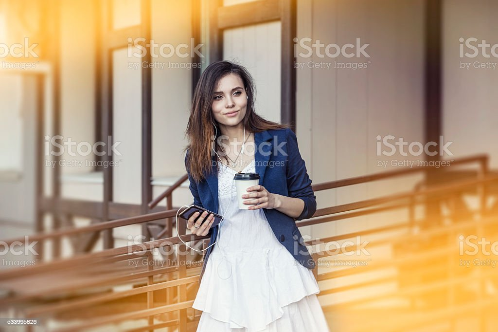 Beautiful young fashion gir with take-away coffee in hand stock photo