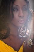 Beautiful young fashion model in yellow dress