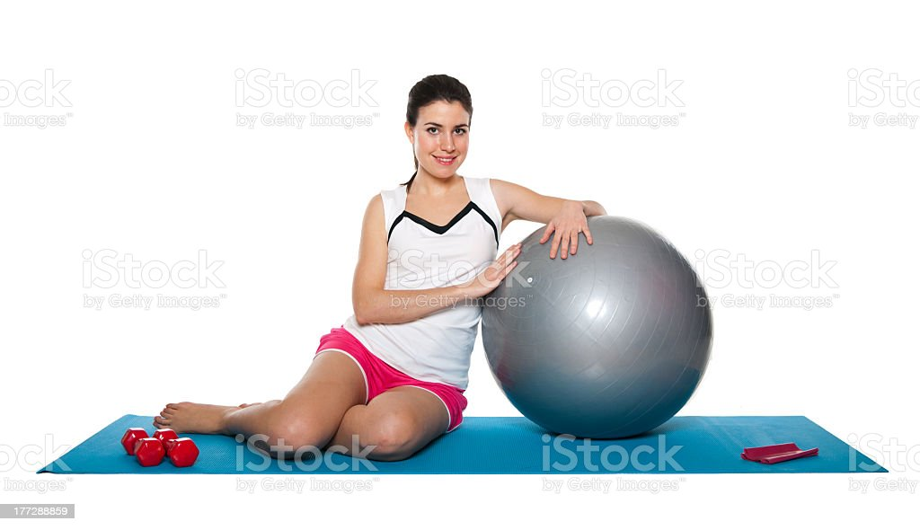Beautiful young female exercising on a blue matt royalty-free stock photo
