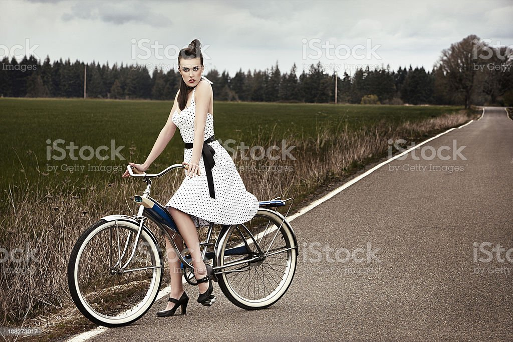 Beautiful Young Female Fashion Model on Bike in Country, Copyspace royalty-free stock photo