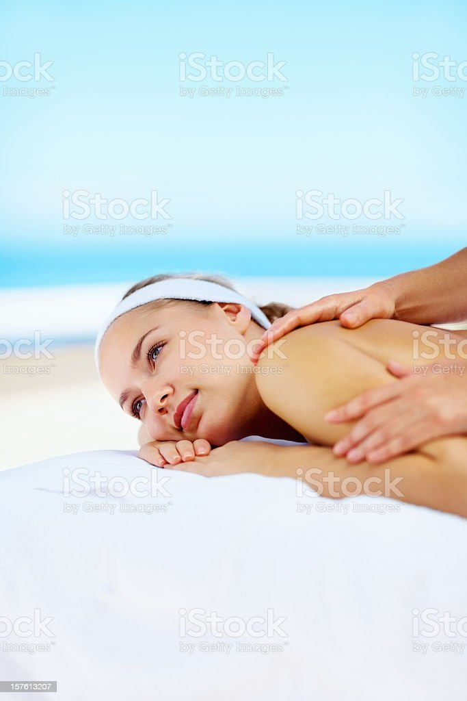 Beautiful young female getting shoulder massage at spa royalty-free stock photo