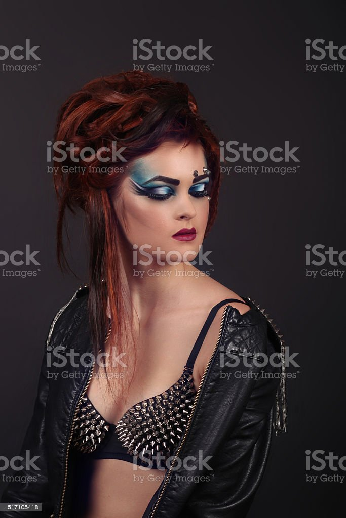 Beautiful young female in a jacket with makeup bra royalty-free stock photo