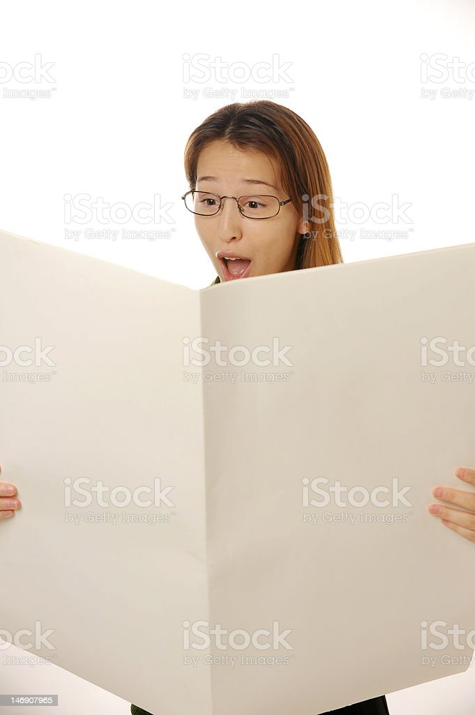 beautiful young female is reading blank newspaper stock photo