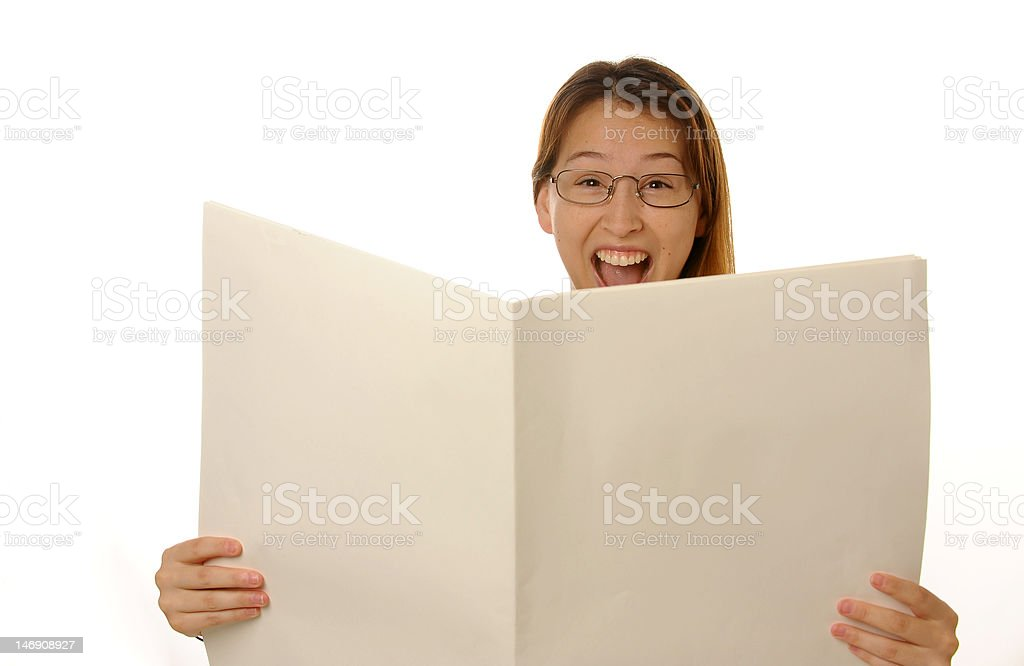 beautiful young female is reading blank newspaper royalty-free stock photo