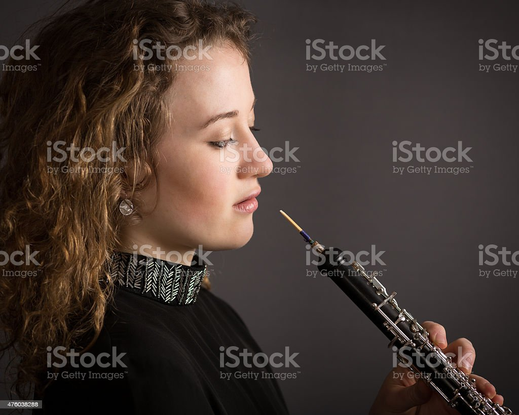 Beautiful Young Female Oboe Player stock photo