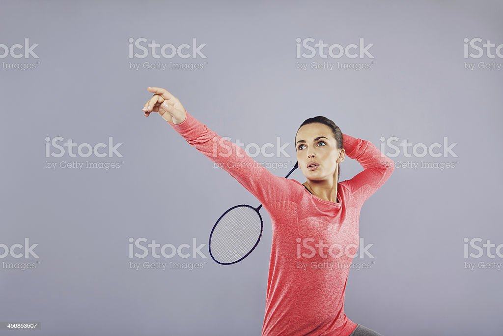 Beautiful young female playing badminton stock photo