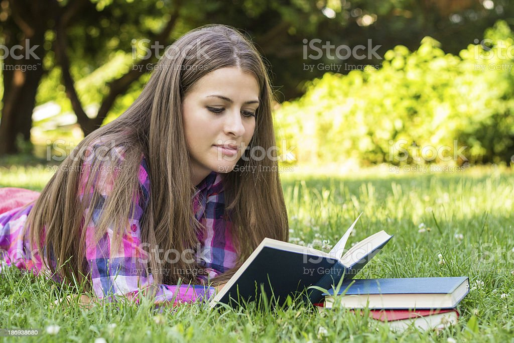 Beautiful young female reading a book royalty-free stock photo