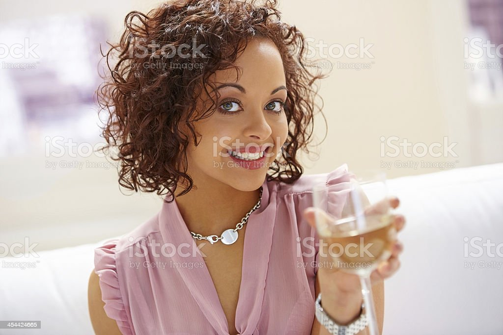 Beautiful young female toasting wine royalty-free stock photo