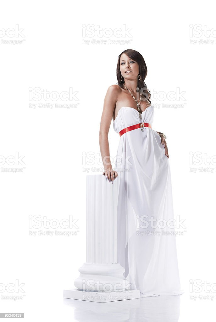 Beautiful young female wearing white dress in antique style royalty-free stock photo