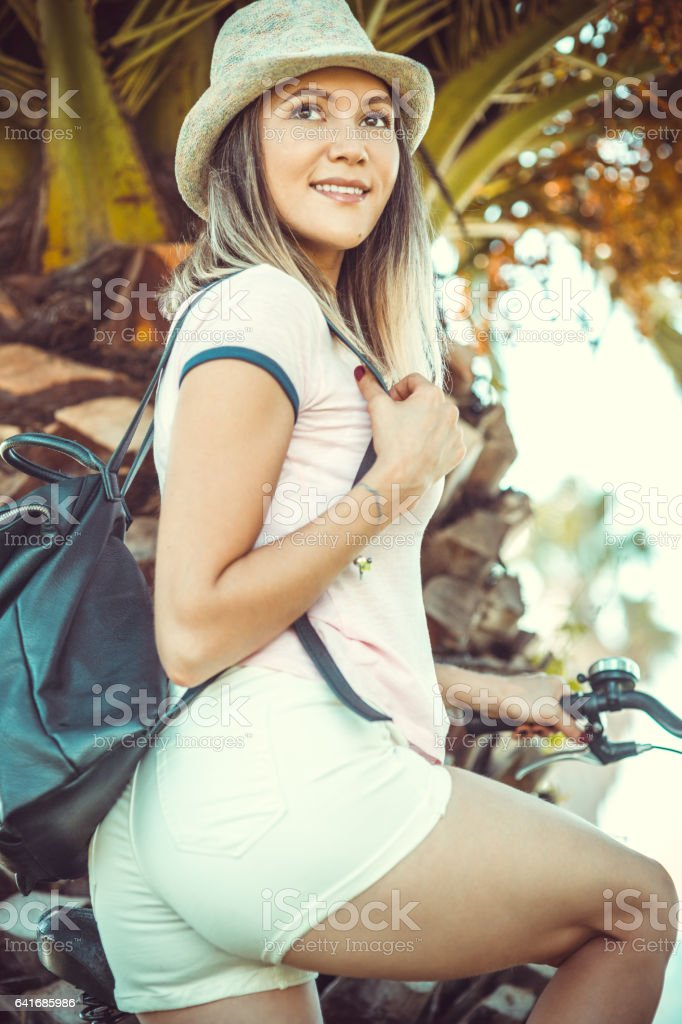 Beautiful young female with rent bicycle stock photo