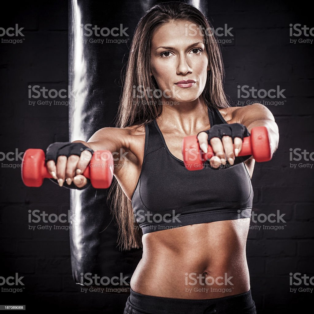 Beautiful young fitness trainer royalty-free stock photo