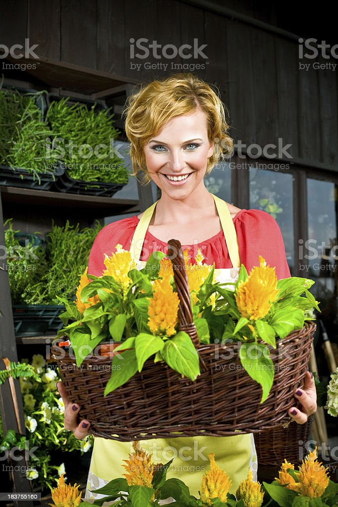 Beautiful young florist in flower shop royalty-free stock photo
