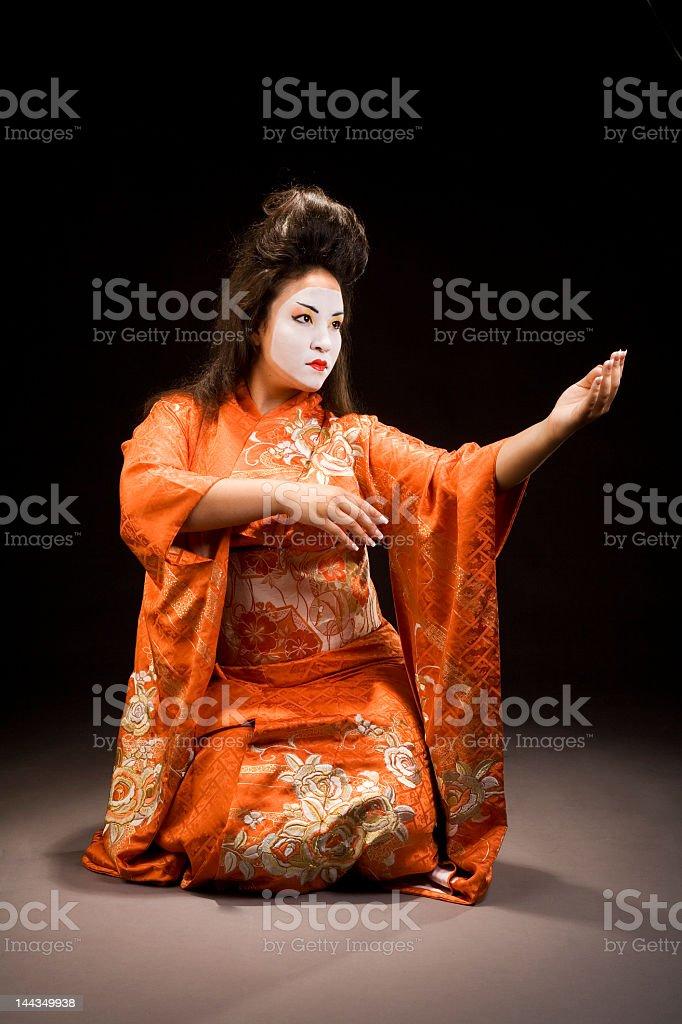 Beautiful young geisha woman in kimono dance pose stock photo