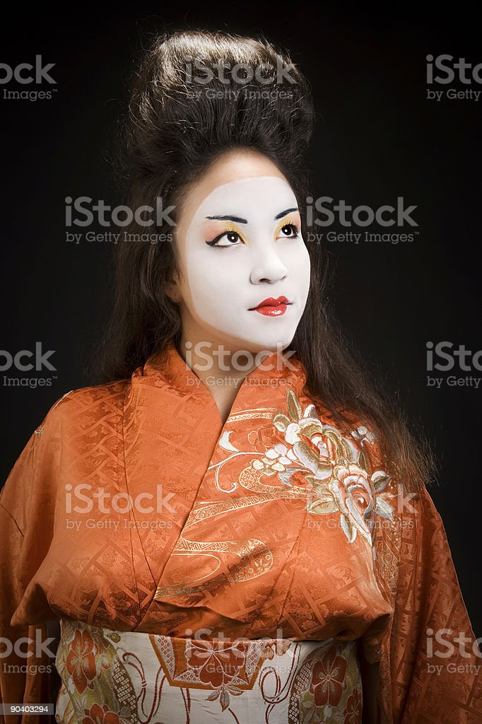 Beautiful young geisha woman in kimono royalty-free stock photo