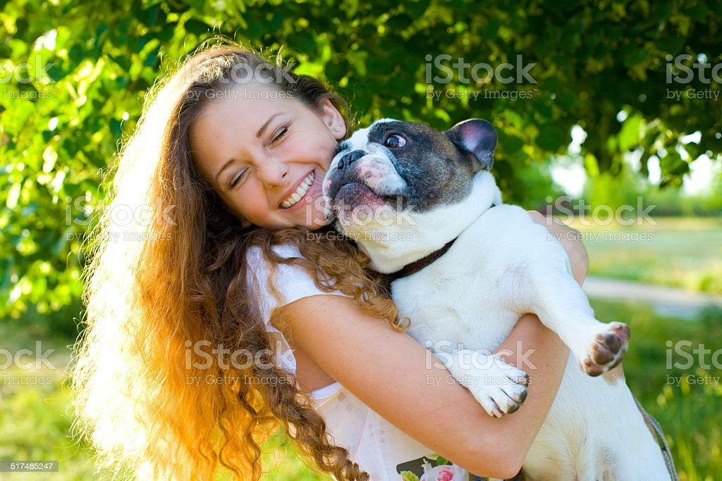 Beautiful young girl and her dog stock photo