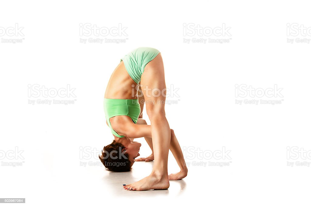 beautiful young girl engaged in yoga, gymnastics, fitness, sports stock photo