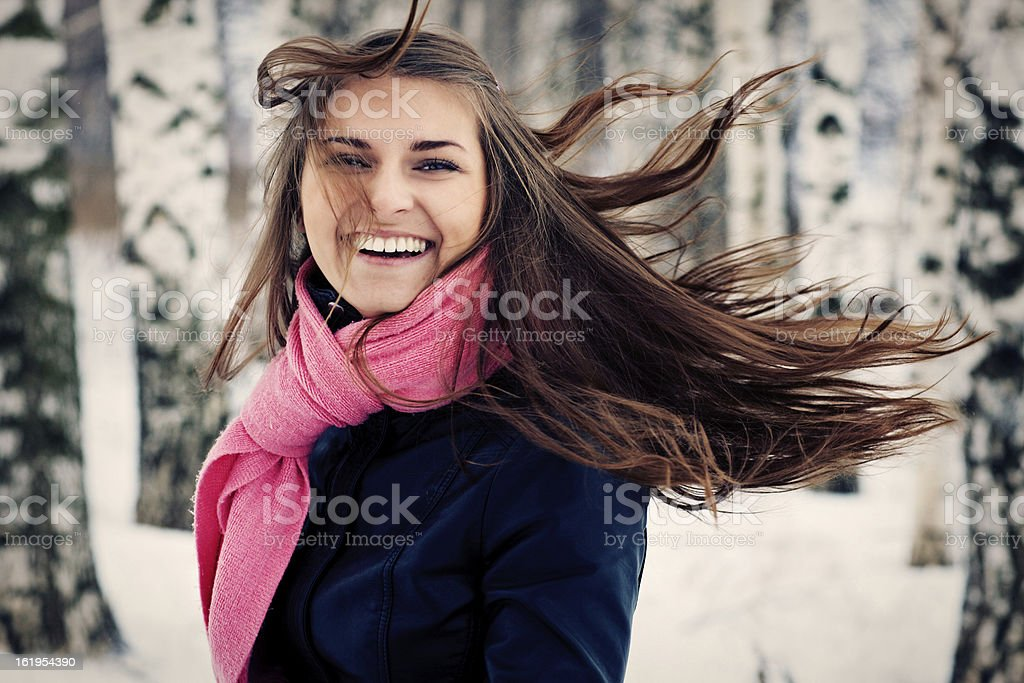 Beautiful young girl happy. Her hair fluttering royalty-free stock photo